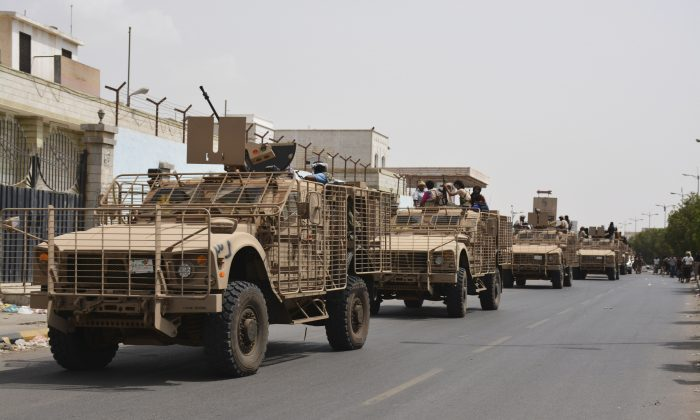 Yemeni fighters against Shiite rebels ride military vehicles on a street in the port city of Aden, Yemen, Tuesday, July 14, 2015. Yemeni forces battling the Shiite rebels in the country's south said they took control on Tuesday of the airport in the strategic port city of Aden, driving the Houthi rebels there into a part of the city jutting out into the sea. (AP Photo/Abo Muhammed)