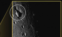 Mysterious 'Mountain Sitting in a Moat' Spotted on Pluto's Moon (Video)