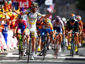 Mark Cavendish celebrates as he crosses the line to win Stage 18 of the 2010 Tour de France. (Bryn Lennon/Getty Images)