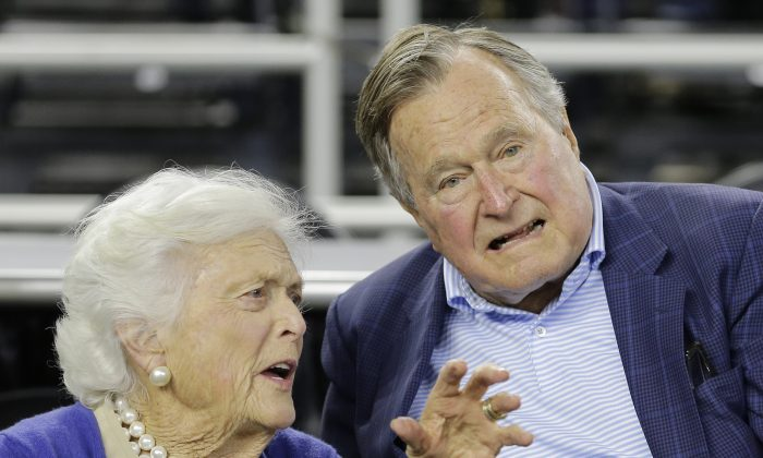 Former President George H.W. Bush and his wife Barbara Bush speak before the first half of an NCAAA college basketball game in Houston, in this file photo. (AP Photo/David J. Phillip)