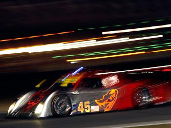 The #45 Flying Lizard Motorsports Riley Porsche driven by Patrick Long, continues to claw back lost laps. (John Harrelson/Getty Images)