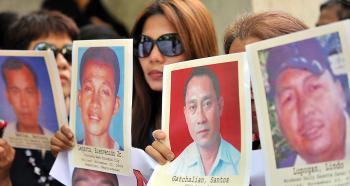 Families of journalists killed during the Maguindanao massacre in the Philippines. (Ted Aljibe/AFP/Getty Images)