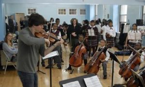 Violinist Joshua Bell Rehearses With Inner-City Kids
