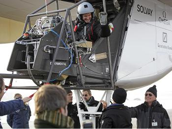 The pilot exults after the flight. (solarimpulse.com)