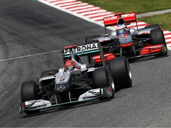Michael Schumacher leads Jenson Button during the Spanish Formula One Grand Prix. (Paul Gilham/Getty Images)