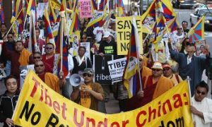 Tibetan Exiles Rally for 50th Anniversary of Uprising