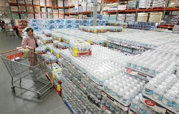 The market for bottled water is huge and growing, as can be inferred by the stacks of cases at this Costco store. But what are customers really buying? (Justin Sullivan/Getty Images)