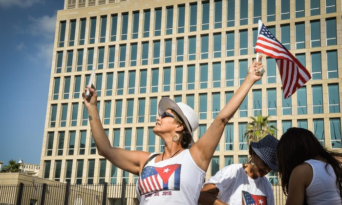 A tourist makes a selfie holding a US Flag in front of the US Embassy in Havana on July 20, 2015.  (Adalberto  Roque/AFP/Getty Images)