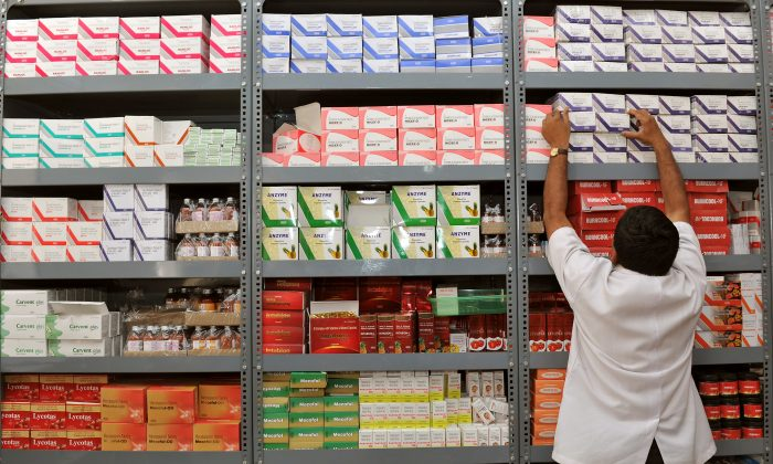 An Indian  pharmacist pulls out a box of medicines from a shelf at a Generic Drug Store at the Victoria Hospital in Bangalore on June 28, 2012. (Manjunath Kiran/AFP/GettyImages)