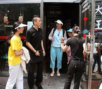 DISCRIMINATION: Ms. Huang Wei, her daughter, and Ms. Sun Zhenyu are forced to leave the Lucky Joy Restaurant, in this file photo from June 1, 2008.  (Evan Mantyk/The Epoch Times)