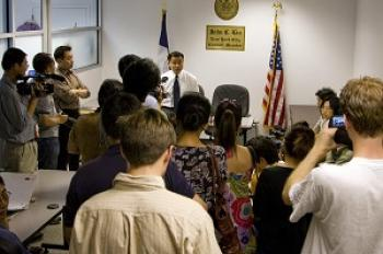 NYC Councilmember John Liu in his Flushing office talks to media before opening his office to constituents who wanted to appeal. He turned away a number of Falun Gong practitioners who had been trying to see him for weeks, yet ushered in several people who had been arrested in connection with violence against Falun Gong. (Edward Dai/Epoch Times)