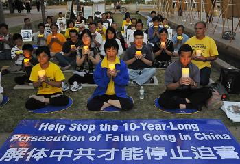 Falun Gong practitioners and supporters in San Diego, Calif. are holding a candlelight vigil in memory of practitioners who lost their lives in the persecution in China. Many similar events around the world are exposing the ten-year persecution. (Alex Li/ The Epoch Times)
