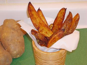 No deep-frying for these potato wedges—they are oven-roasted to a golden brown. (Sandra Shields/The Epoch Times)