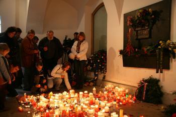 People light candles on the Velvet Revolution memorial plaque, where police beat students on Nov. 17, 1989, in Prague. (Milan Kajinek/The Epoch Times )