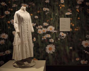 A white dress worn by Dickinson displayed at the exhibition. (Talisman Brolin)