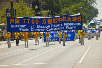 Practitioners of Falun Gong peacefully march near the White House on July 23. (Mark Zou/The Epoch Times)