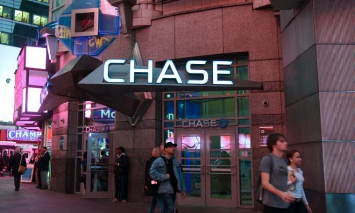 Pedestrians walk past the Chase Bank in the heart of Times Square on 42nd Street on Nov 28. (Benjamin Chasteen/The Epoch Times)
