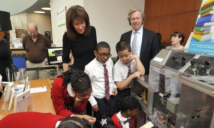 Third-graders watch as children's books are printed with the Espresso Book Machine at the Brooklyn Public Library on Wednesday. (Phillip Greenberg/Courtesy of Berlin Rosen)