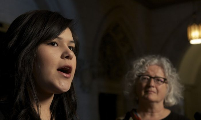 Chelsea Edwards talks to reporters on Feb. 27 as NDP Aboriginal Affairs critic Linda Duncan looks on. (Matthew Little/The Epoch Times)