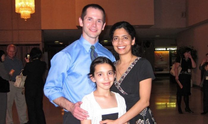 Dr. John T. Coates and his wife, Dr. Shalini-Coates, and their daughter Anjalie attend Shen Yun Performing Arts in Toledo. (Valerie Avore/The Epoch Times)