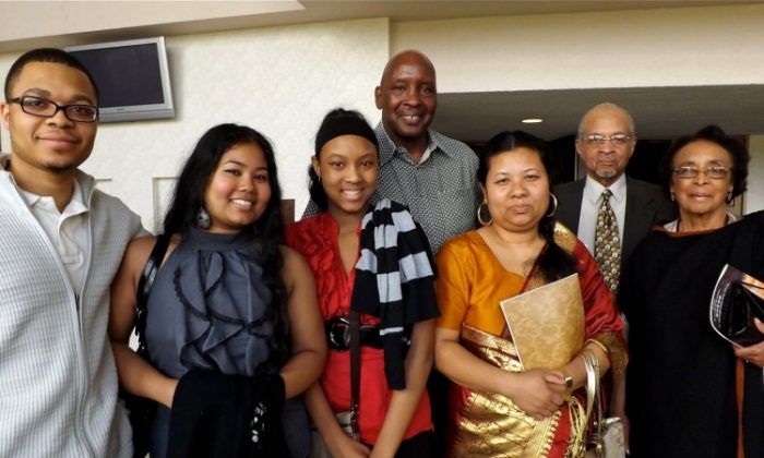 (L to R) Family friend, two daughters, Judge Earl Ashford and wife, father and mother, attend Shen Yun Performing Arts In Toledo. (Courtesy of SOH radio network)
