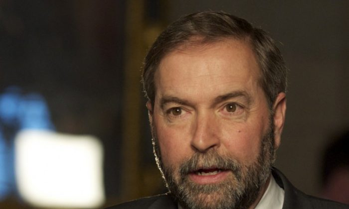 Newly anointed NDP leader Thomas Mulcair speaks with reporters after his first day in Parliament. With the looming prospect of Tory attack ads, the NDP are prepared to defend the image of their leader. (Matthew Little/The Epoch Times)