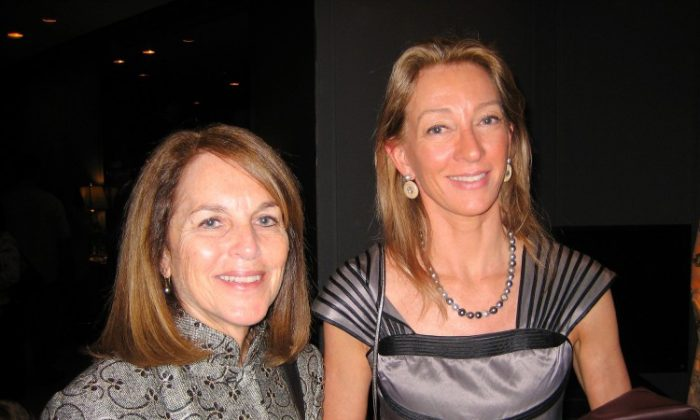 Cathy Tamraz (L), CEO of Business Wire, poses for a photograph with writer, Janet Crawford, during the intermission of Shen Yun Performing Arts at the Lincoln Center's David H. Koch Theater on April 19. (Joshua Philipp/The Epoch Times)