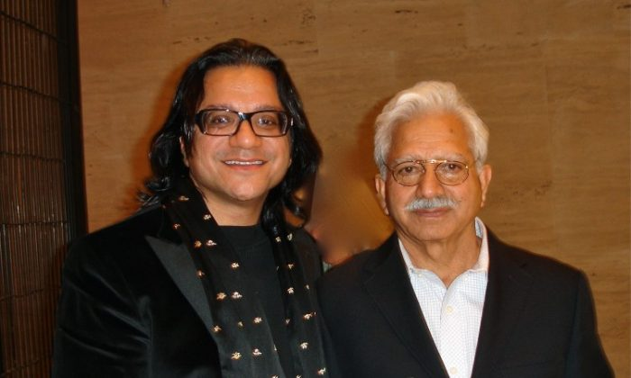 Dr. T. Rajiv Juneja M.D., M.S. and his father attend Shen Yun Performing Arts in New York. (Hannah Cai/The Epoch Times)