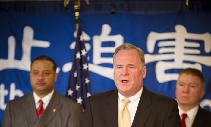 New York Assemblyman Michael J. Fitzpatrick speaks at a press conference supporting Falun Gong in Albany, NY on April 25, 2012. Assemblyman Eric A. Stevenson stands to his left and Assemblyman Mark Johns to his right. (Edward Dai/The Epoch Times)