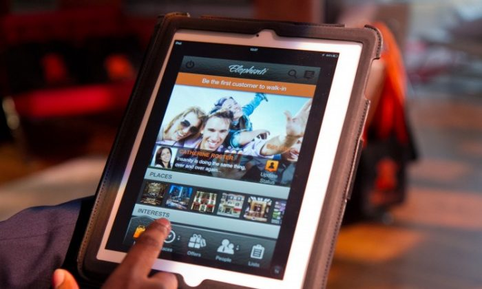 Elephanti is a new lifestyle app available in July that is designed to allow users to discover and follow their favorite stores, venues, and brands through their mobile devices, on May 16 at the Internet Week conference in New York. (Benjamin Chasteen/The Epoch Times)