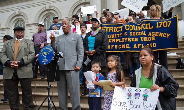 Council member Charles Barron speaks at a protest against the mayor's scheduled cuts for subsidized child care and the Head Start program on the steps of City Hall on May 23. (Benjamin Chasteen/The Epoch Times)
