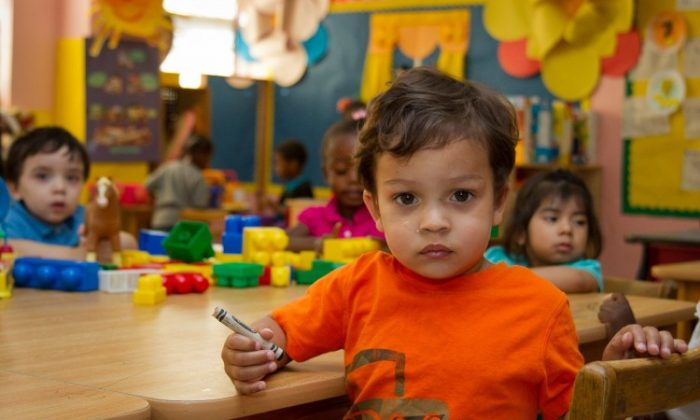 Children sit in a classroom at the Bethel Day Care Center in Brooklyn, N.Y., on June 14, 2012. (Benjamin Chasteen/The Epoch Times)