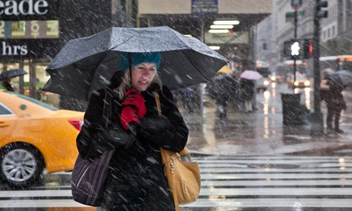 A woman takes shelter under her umbrella during the nor'easter storm in New York on Wednesday, Nov. 7. (Amal Chen/The Epoch Times)