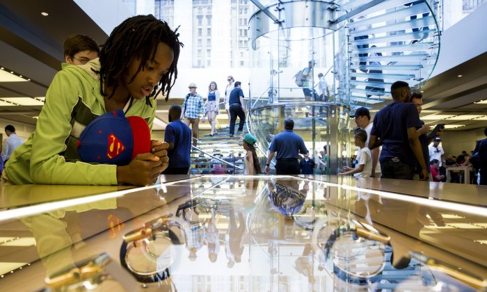 A customer looks at the Apple Watch at the Apple Store on June 17, 2015 on Fifth Avenue in New York City. (Eric Thayer/Getty Images)