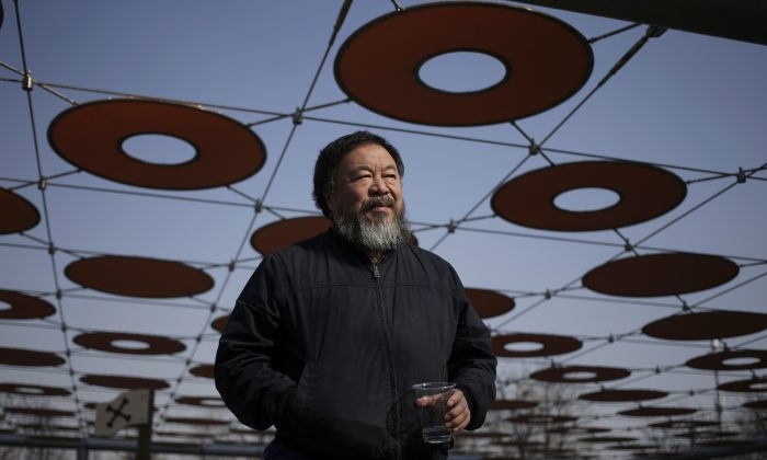 Chinese dissident artist Ai Weiwei walks near a playground outside a shopping mall in Beijing on March 24. (Andy Wong/AP Photo)