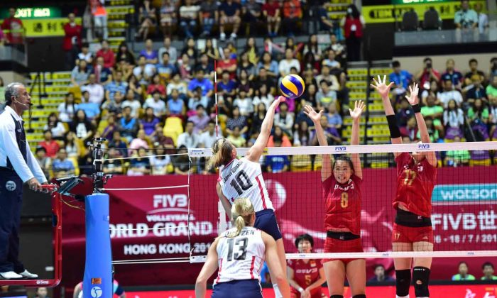 Larson-Burbach of the USA spikes a return during their match against China in the FIVB Grand Prix preliminary competition at the Coliseum Hong Kong on Saturday July 18, 2015. (Bill Cox/Epoch Times)