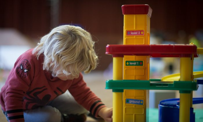 A young boy plays with toys at a pre-school in this file photo. (Matt Cardy/Getty Images)