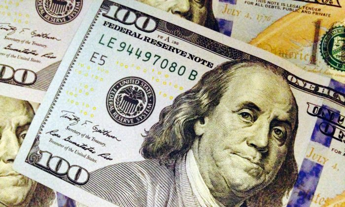 FILE - This Feb. 2, 2015, file photo, depicts a part of a U.S. $100 bill. (AP Photo/Jon Elswick, File)