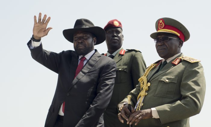 South Sudan's President Salva Kiir (L) accompanied by Army Chief of Staff Paul Malong Awan (R) during an Independence Day ceremony in the capital Juba, South Sudan, on July 9. South Sudan marked four years of independence from Sudan on Thursday, but the celebrations were tempered by concerns about ongoing violence and the threat of famine. (Jason Patinkin/AP)