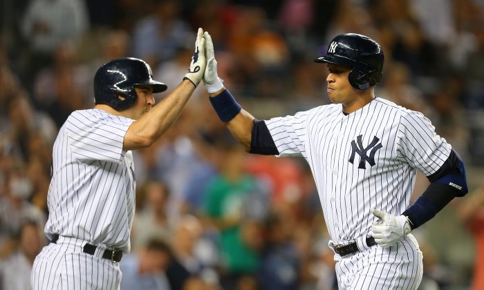 Alex Rodriguez (R) has surprised nearly everyone with his hitting this year. (Mike Stobe/Getty Images)