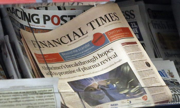 "The Financial Times newspaper is on display in London, Thursday, July 23, 2015. Pearson PLC, the owner of the Financial Times, confirmed Thursday it is in ""advanced discussions"" about the potential sale of the FT Group. (AP Photo/Frank Augstein)"