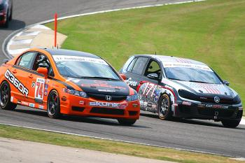 Wheel-to-wheel through the corners&#8212a trademark of touring car action. (James Fish/The Epoch Times)