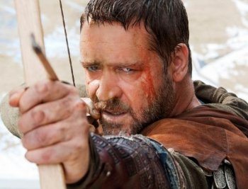 Robin Hood: Russell Crowe takes aim at an enemy in the newest adaptation of Robin Hood, this time directed by Ridley Scott. (Kerry Brown/Universal Studios)