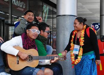 Italian pilgrims singing on Sydney's streets, meet a Pacific Island pilgrim. (Sonya Bryskine/The Epoch Times)