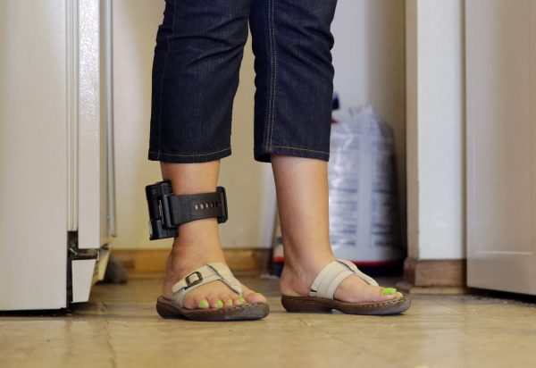 An immigrant from Honduras that entered the country illegally wears an ankle monitor at a shelter in San Antonio on Monday, July 27, 2015. (AP Photo/Eric Gay)