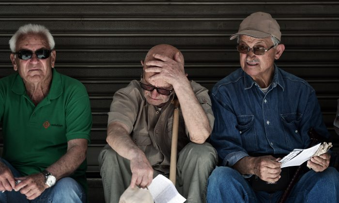 Pensioners outside the Ministry of Health in Athens during a 24-hour strike by health workers and doctors demanding funds and additional staff, on May 20, 2015. (Louisa Gouliamaki/AFP/Getty Images)