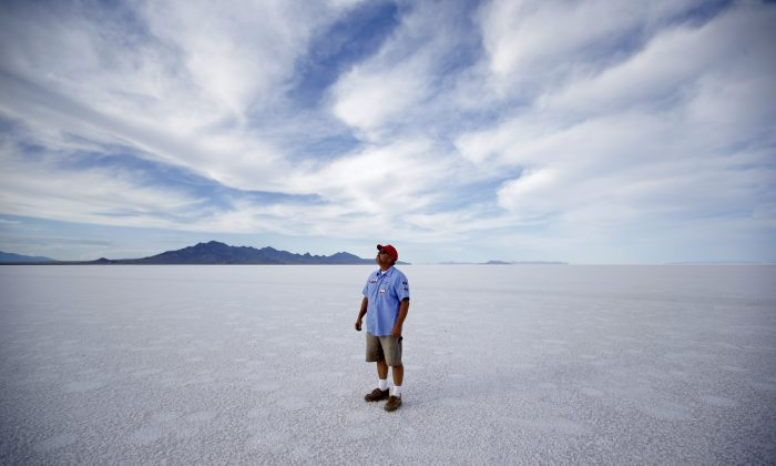 In this Monday, July 20, 2015 photo, Bill Lattin, the Southern California Timing Association president and Speed Week race director, stands in the Bonneville Salt Flats in Utah. (AP Photo/Rick Bowmer)