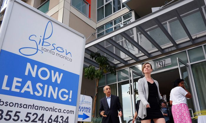 Visitors arrive for the grand opening of Gibson Santa Monica, a new luxury apartment complex in downtown Santa Monica, Calif., on March 18, 2015. (AP Photo/Richard Vogel)
