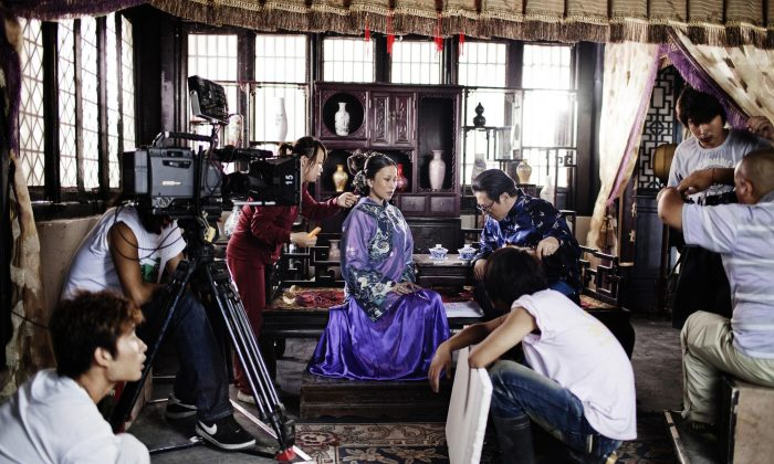 A scene for a TV series is shot at Hengdian World Studio in China, which features a 1:1 scale reproduction of the Forbidden City. The Chinese Ministry of Culture and rich local investors see the country's film industry as an instrument of soft power abroad. Taken by Giullio Di Sturco of Italy, the photo won First Prize, Contemporary Issues, Singles. (Giullio Di Sturco, Italy)