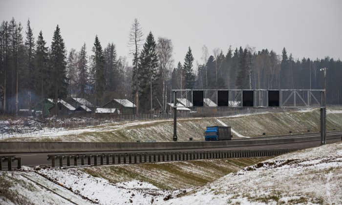 A truck drives along a new highway in Moscow region on Nov. 17, 2015. As the climate warms, moisture levels are changing with wet areas becoming wetter and dry areas drier. Russia is the fastest warming part of the world, according to a report from the country's weather monitoring agency. The steady rise in temperatures puts Siberia—known for its long winters and lush forests—at risk to natural disasters, such forest fires. (AP Photo/Alexander Zemlianichenko)